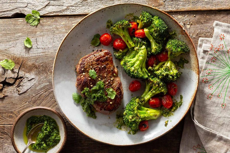 Steaks with chermoula, roasted vegetables, and pesto