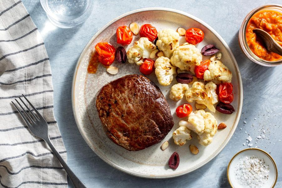 Seared steaks with roasted red pepper ajvar and cauliflower