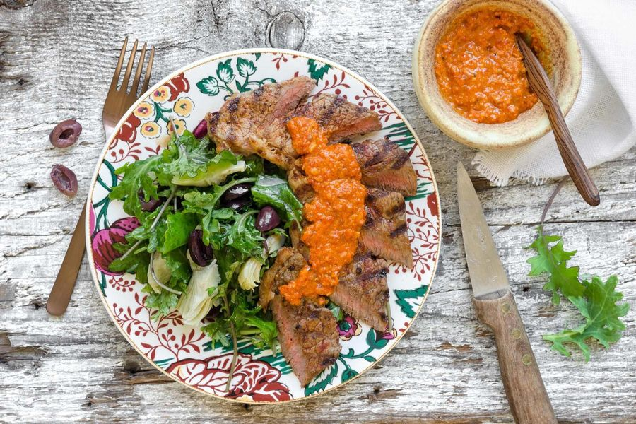 Steak with romesco sauce and kale salad