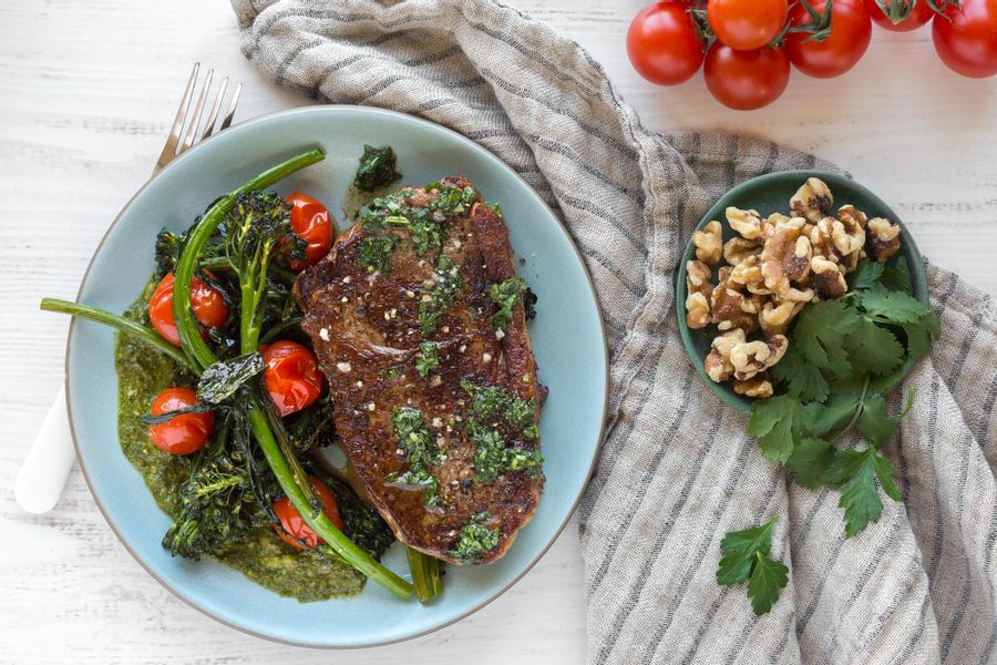 Steak with roasted broccolini and tomatoes
