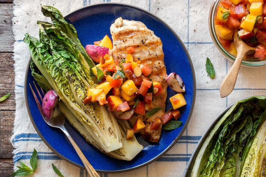 Chicken breasts with charred romaine and stone fruit–almond salsa