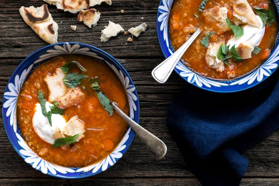 Turkish red lentil soup with yogurt and naan croutons