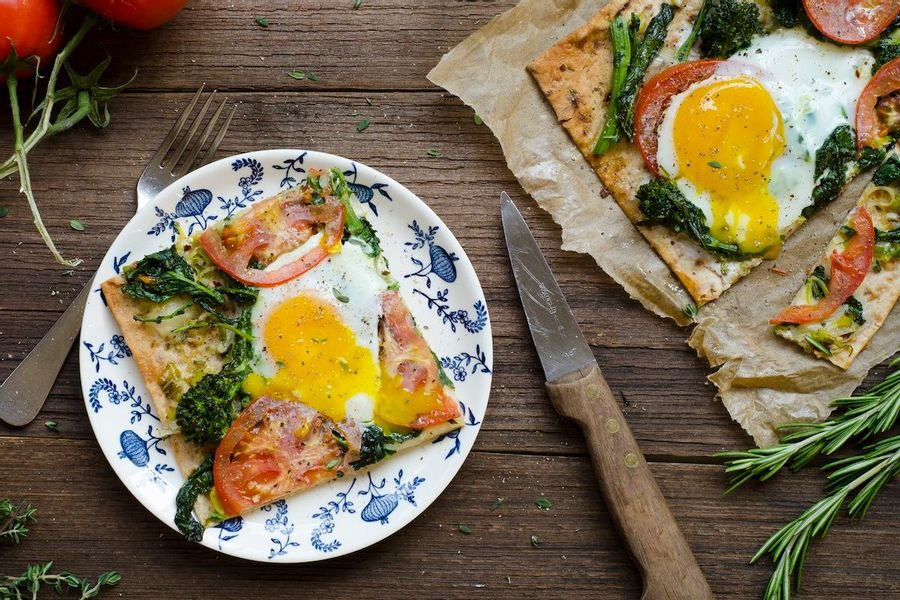 Leek and broccoli rabe flatbread with a fried egg