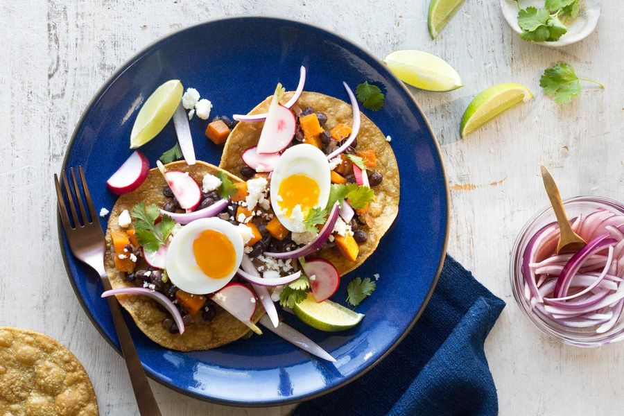 Black bean tostadas with squash, pickled onion, and soft-cooked eggs