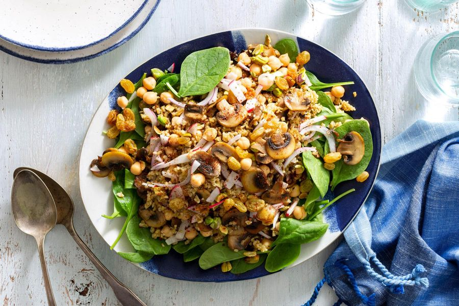 Mediterranean chickpea salad with freekeh, mushrooms, and pistachios