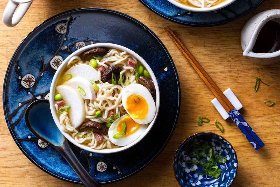 Miso ramen bowls with pancetta, edamame, and soft-cooked eggs