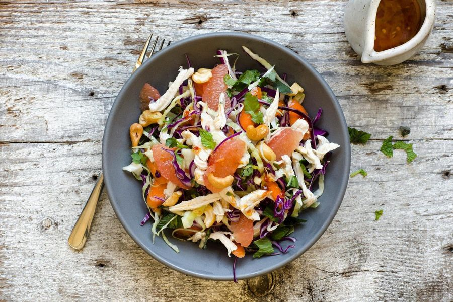 Shredded chicken and cabbage salad with grapefruit and toasted cashews