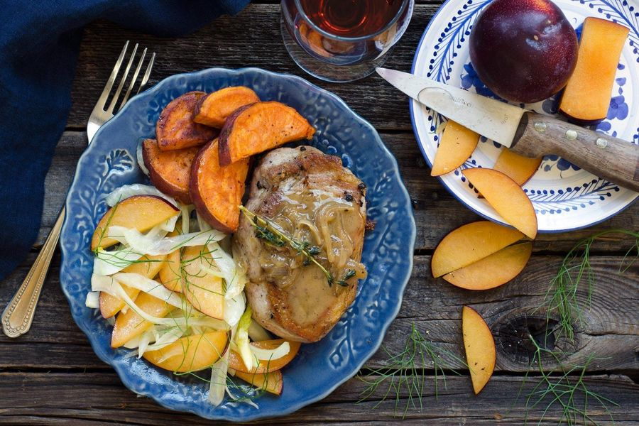 Grilled pork chops with plum and fennel salad and roasted sweet potatoes