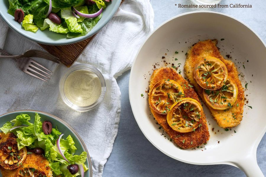 Chicken Milanese with charred lemon and insalata romana