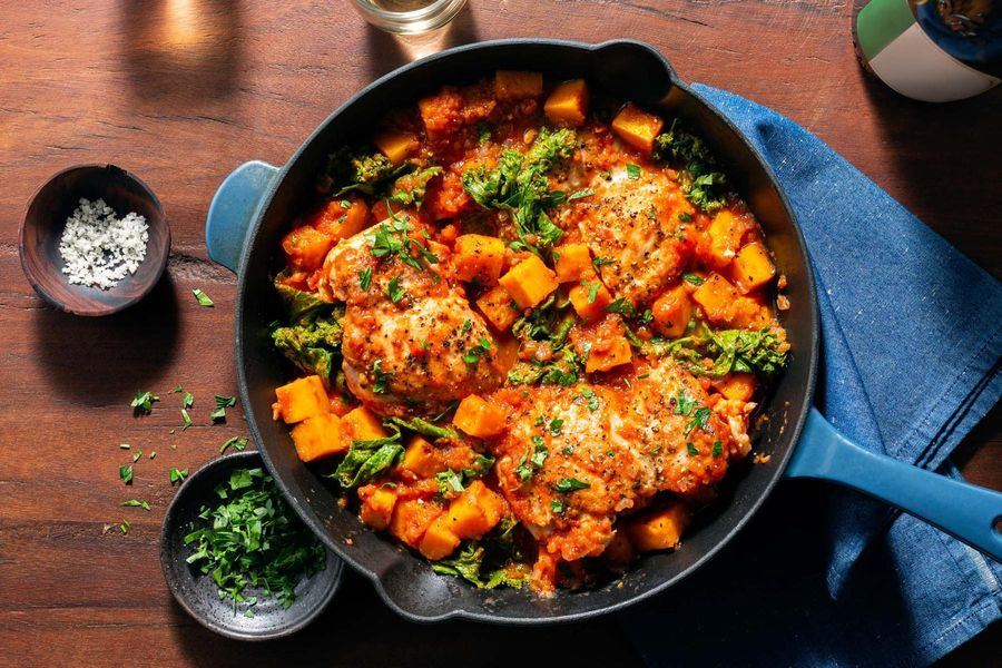Tomato-braised chicken with butternut squash and leafy greens