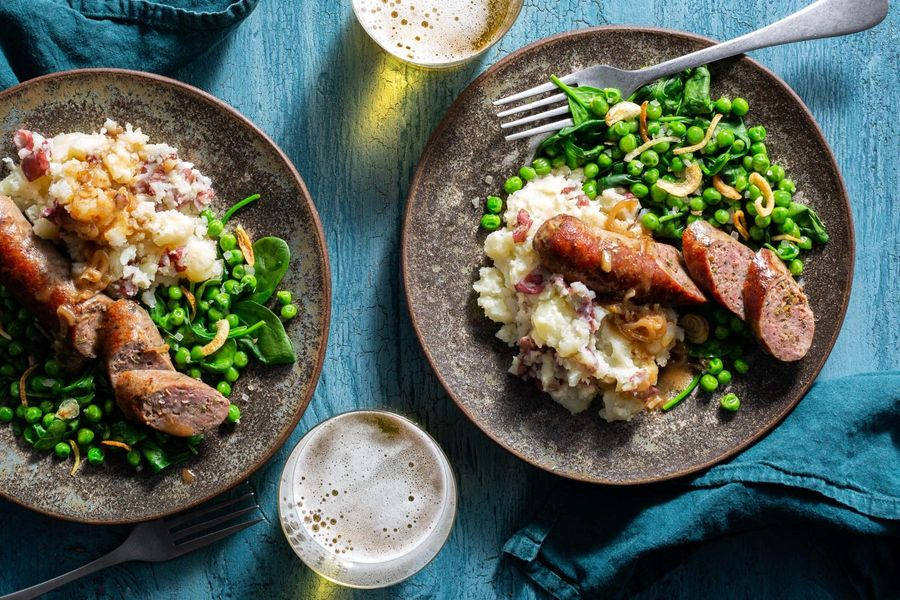 Bangers and mash, shallot gravy, and peas and spinach