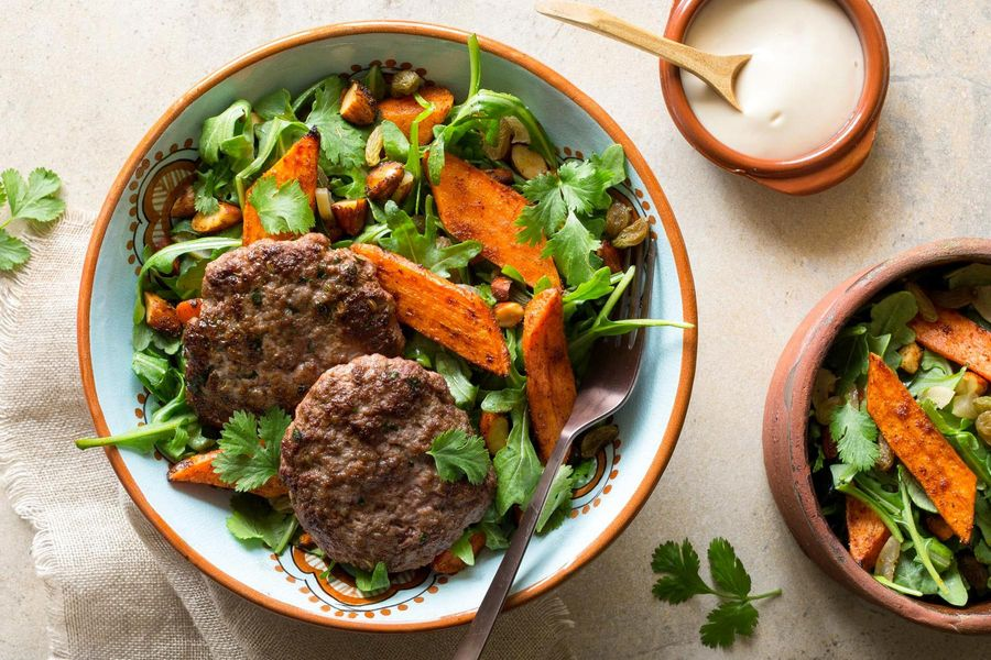 Moroccan lamb merguez patties with warm carrot salad