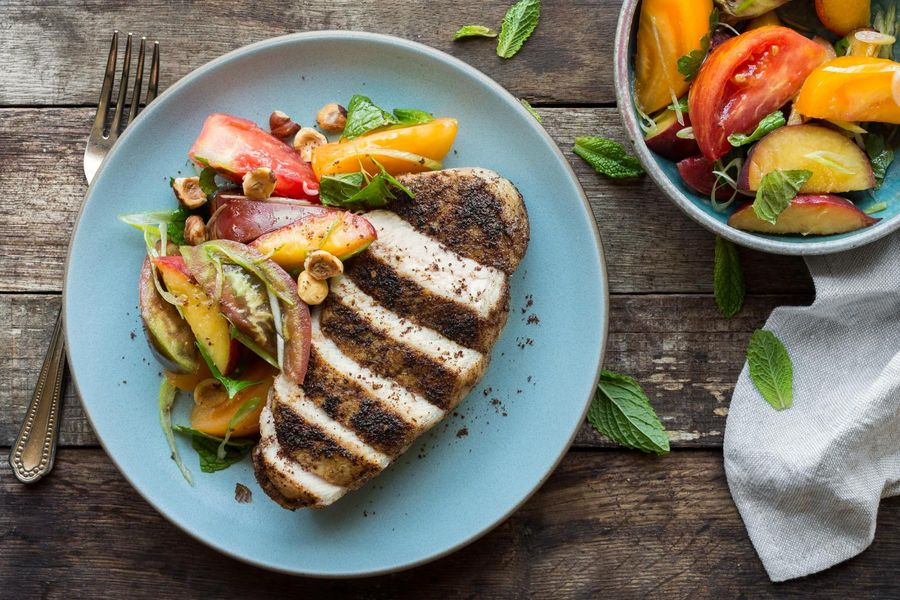 Harissa-rubbed pork chops with peach-tomato salad