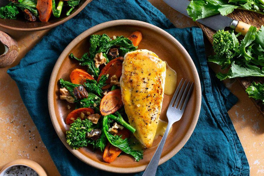 Orange-glazed chicken with broccoli rabe, carrots, and dates
