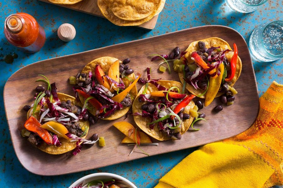 Spicy Jamaican black bean tostadas with peppers and chicory-nectarine slaw