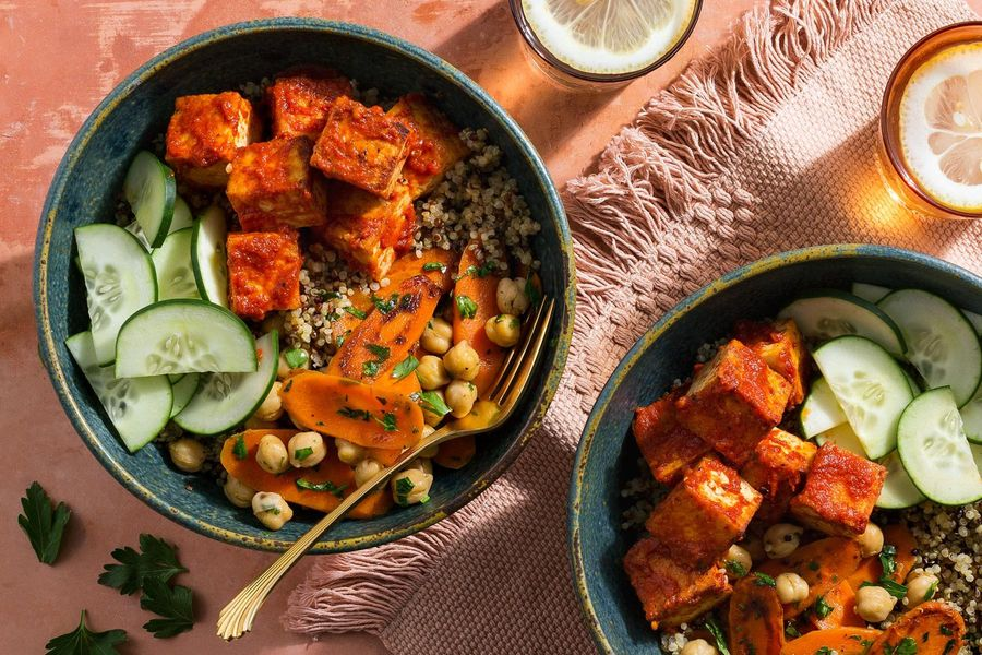 Spicy harissa tofu and quinoa bowls with carrots and chickpeas