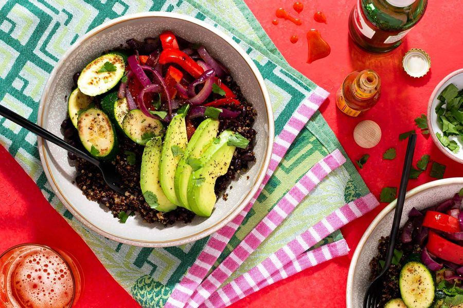 Black bean and quinoa Buddha bowls with zucchini and avocado