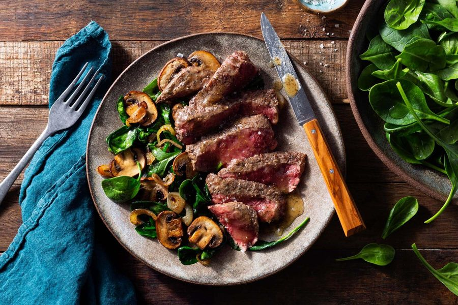Black Angus steaks with garlic-herb ghee, mushrooms, and spinach