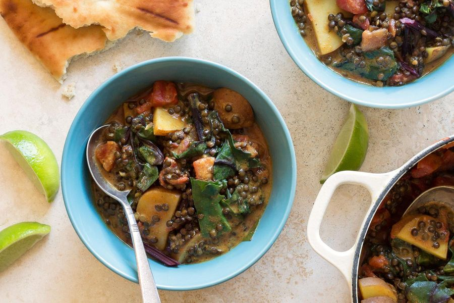 Curried black lentils and potatoes with chard and naan