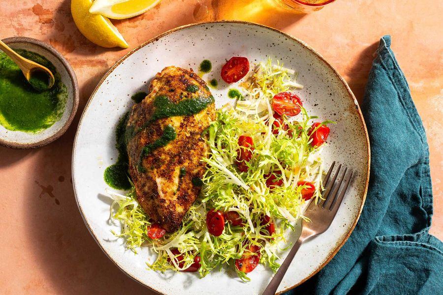 Santa Fe spiced chicken breasts with warm tomato-frisée salad
