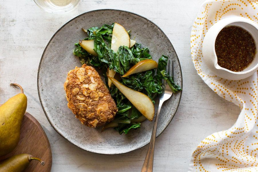 Almond-crusted pork with sautéed mustard greens and pears