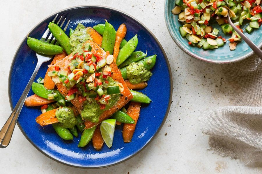 Salmon with snap peas, carrots, and red pepper–almond salsa