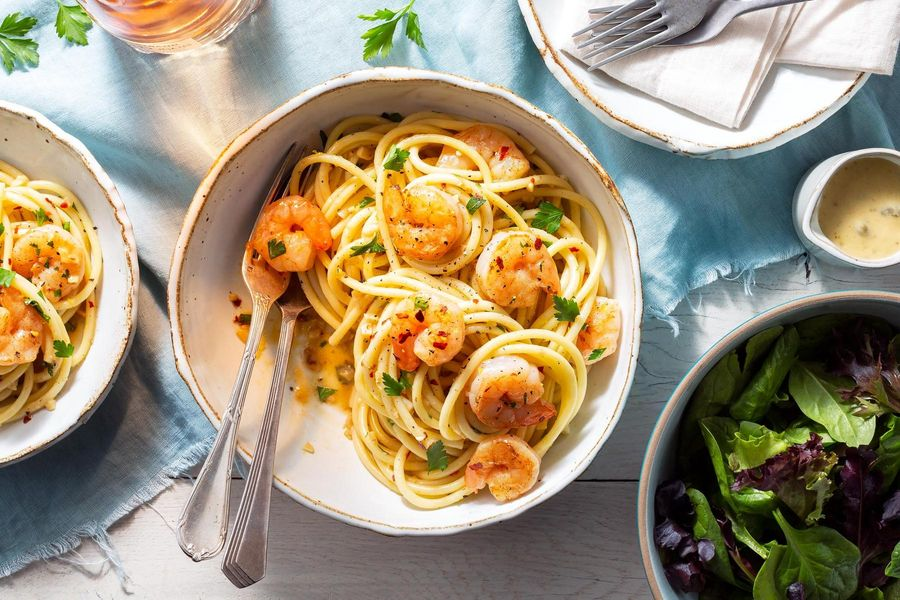 Shrimp scampi with bucatini and baby greens