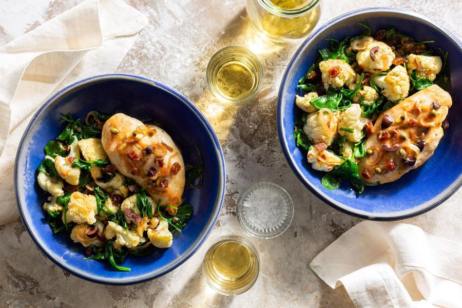 Chicken Marbella with pan-roasted olives, dates, and cauliflower