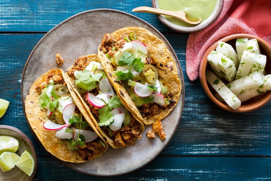 Tofu mole tacos with jicama, radish, and avocado crema