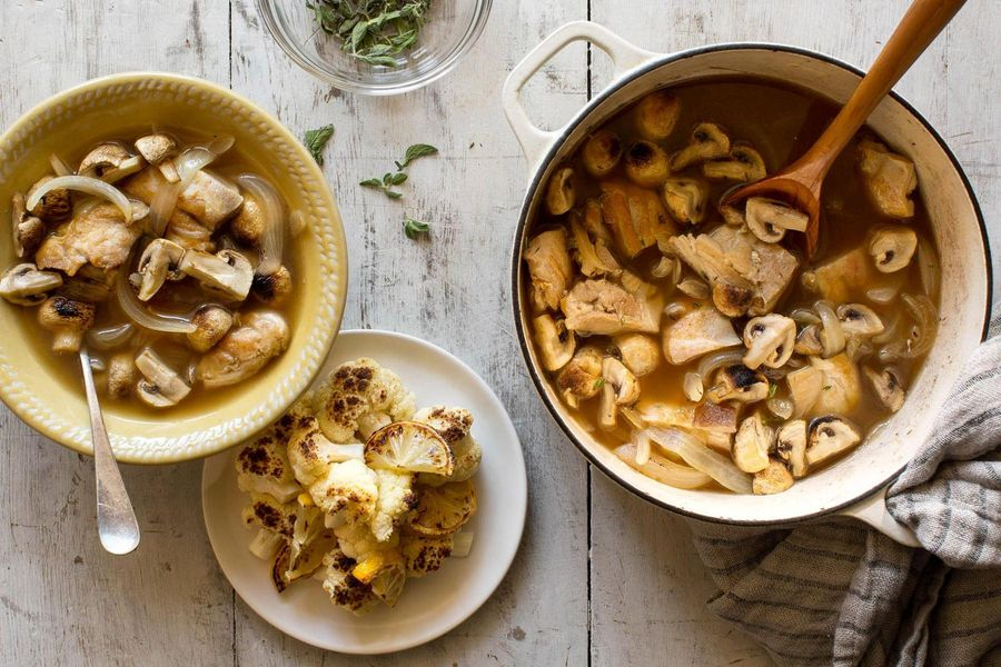 Braised chicken and mushrooms with roasted cauliflower and lemon