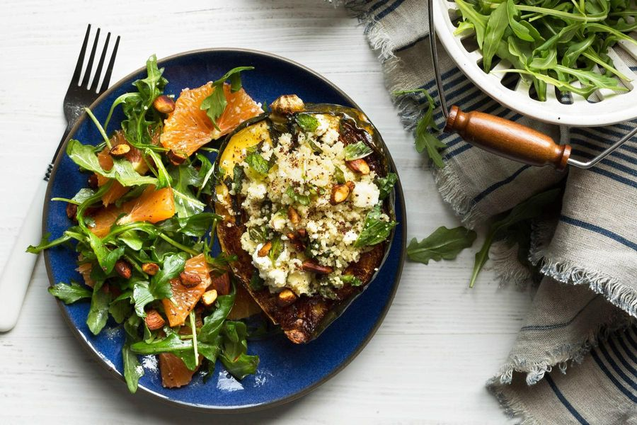 Roasted acorn squash with couscous and arugula-orange salad