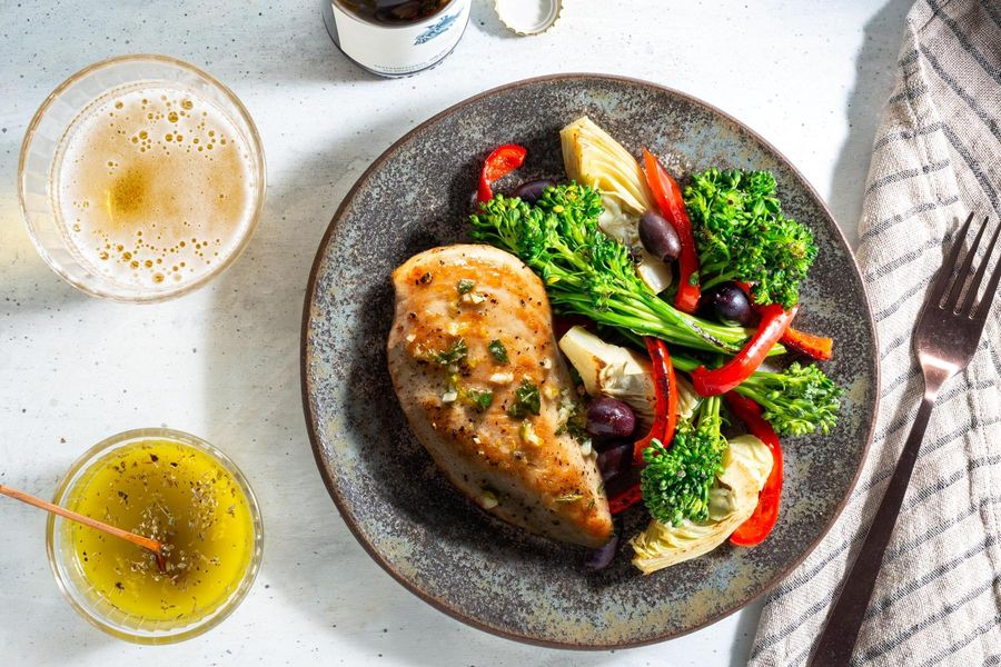 Mediterranean lemon chicken with baby broccoli, artichokes, and olives