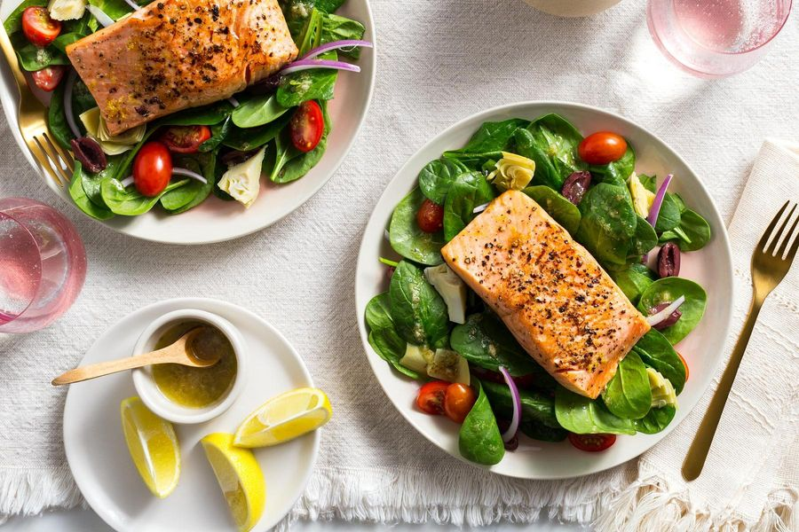 Lemon-pepper salmon over Greek salad with artichokes and olives