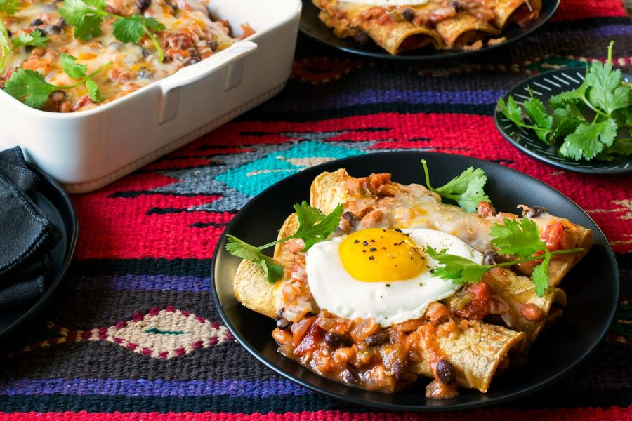 Two-bean enchiladas with Southwestern chile sauce and fried eggs