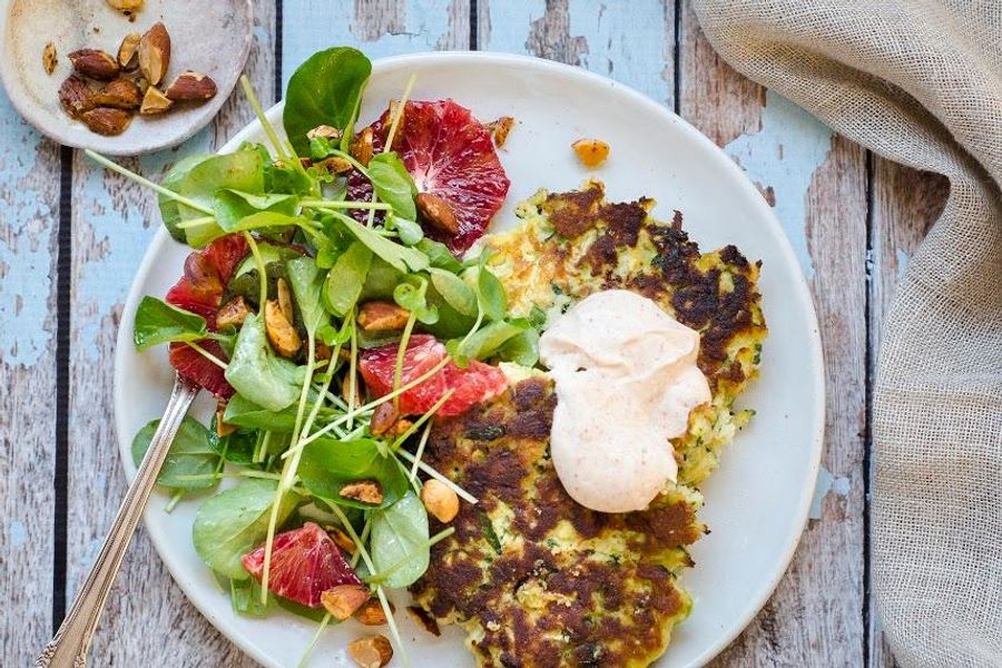 Zucchini fritters with spiced yogurt, watercress and toasted almonds