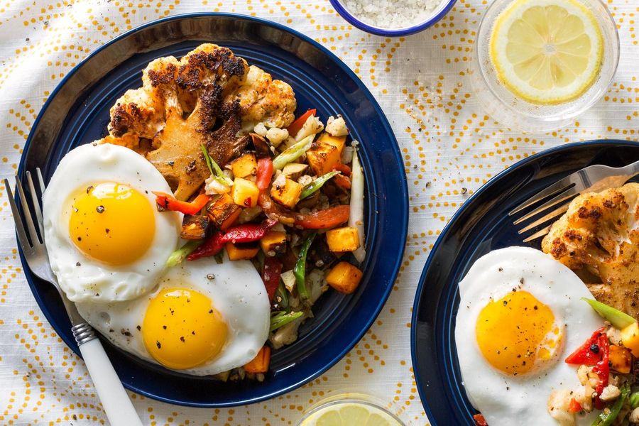 "Cauliflower ""steaks"" with fried eggs and sweet potato–scallion hash"