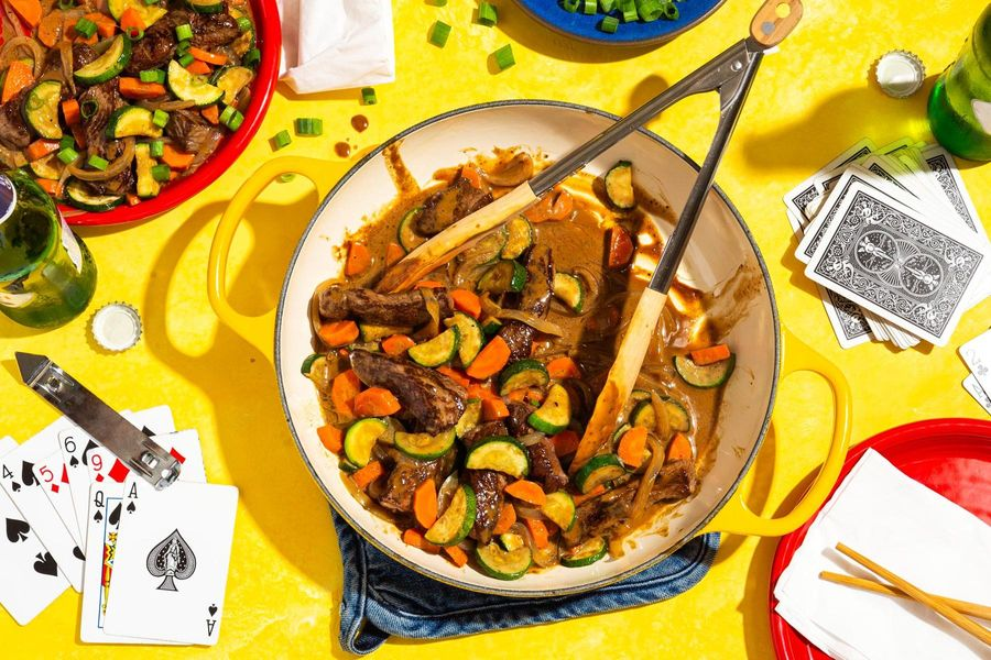 Steak and vegetable stir-fry with cashew-plum sauce