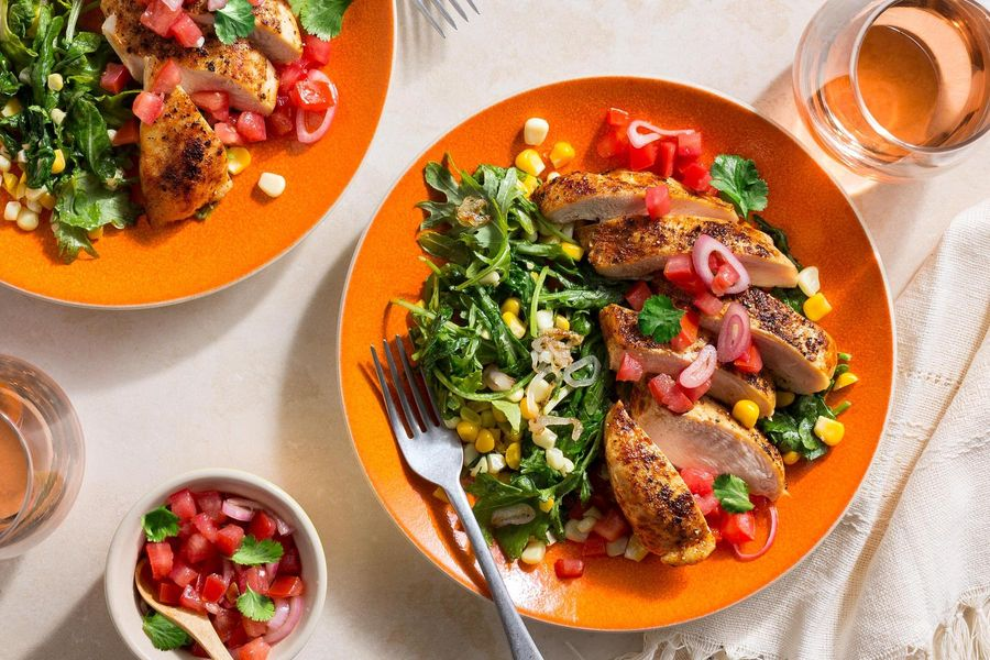 "Paprika-spiced chicken over ""creamed"" corn with tomato salsa"
