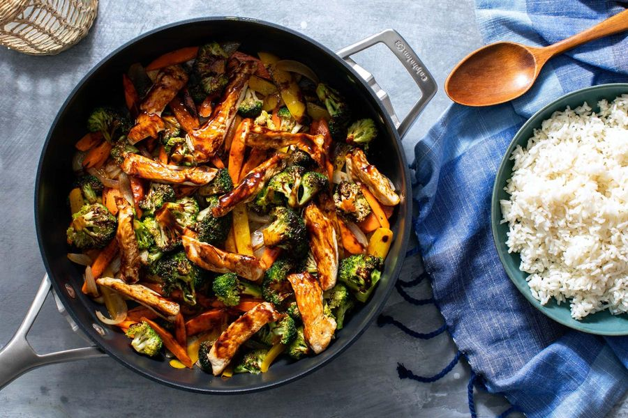 Hot and sour chicken stir-fry with vegetables and rice