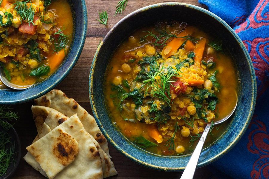 Chickpea and red lentil dal with kale and warm naan