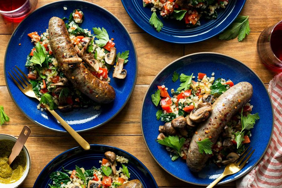 Italian sausages with warm cauliflower-kale salad and artichoke romesco