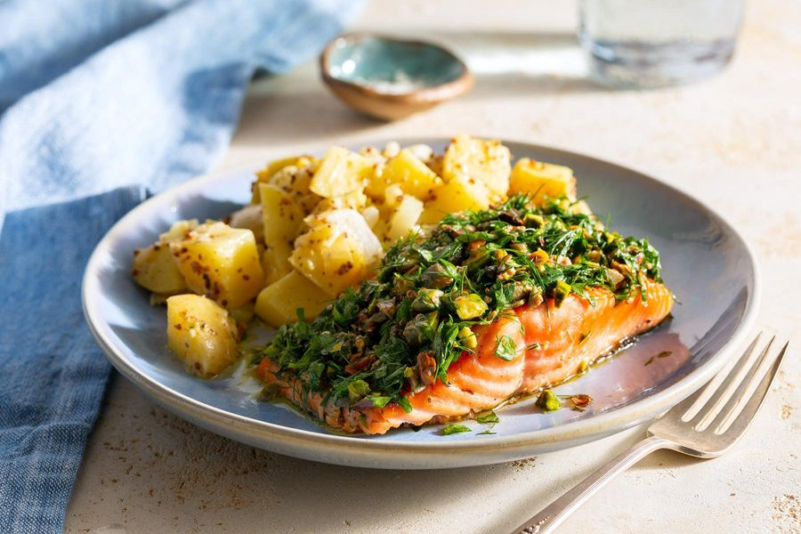 Salmon with pistachio-herb dressing and warm potato-leek salad