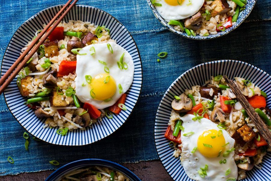 Fried rice with braised tofu, green beans, and sunny-side up eggs
