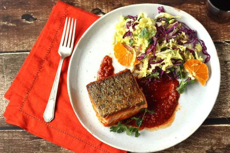 Seared salmon in chraimeh sauce with winter slaw
