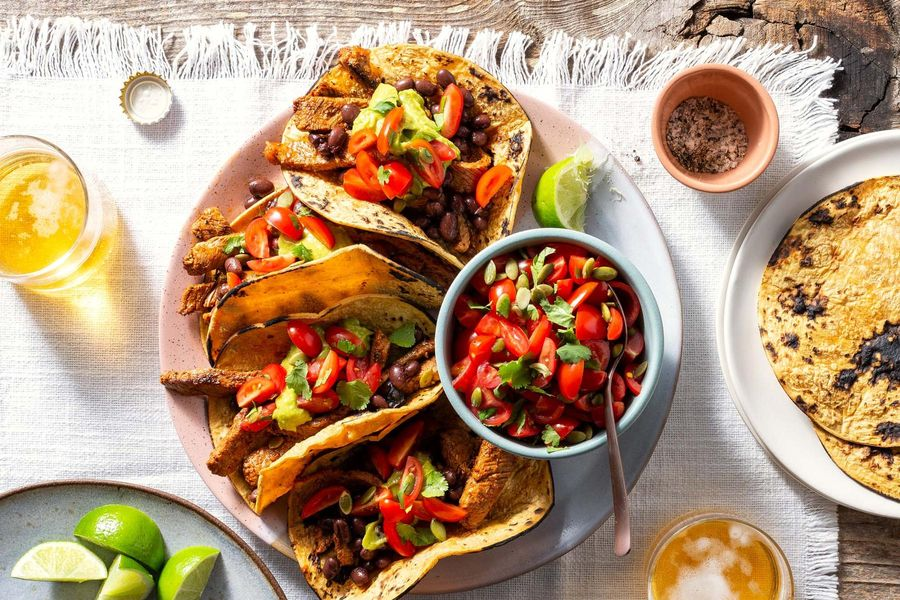 Spicy mojo-marinated steak fajitas with guacamole and salsa