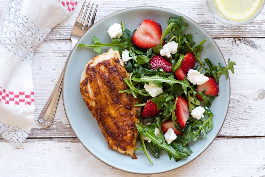 Roasted chicken with wild arugula, goat cheese and strawberries