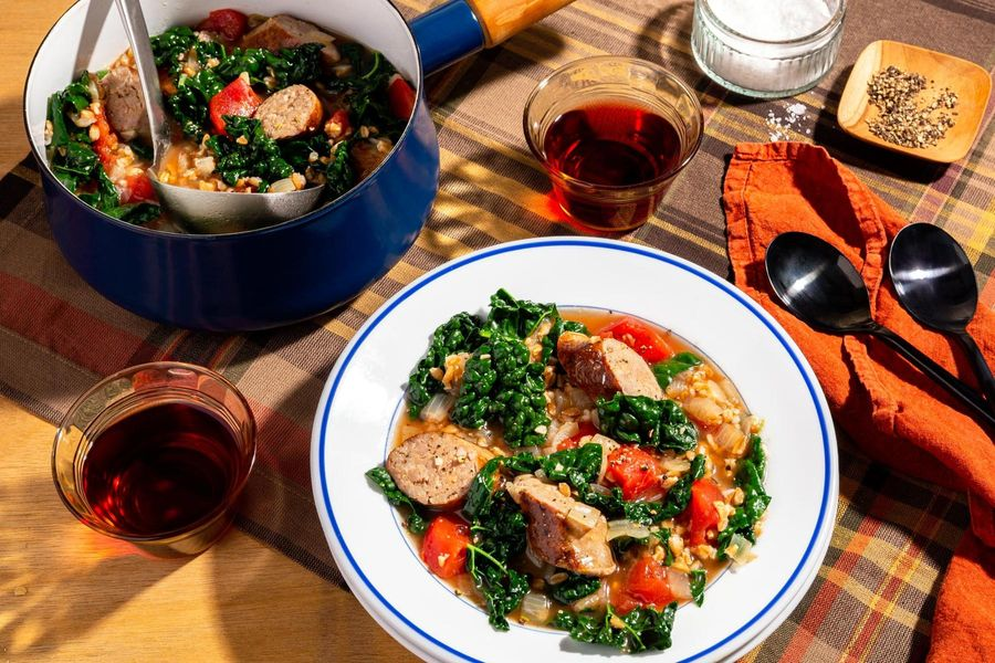 Farro soup with Italian sausages and kale