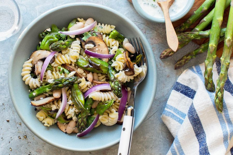 Quinoa pasta salad with asparagus and basil-yogurt dressing