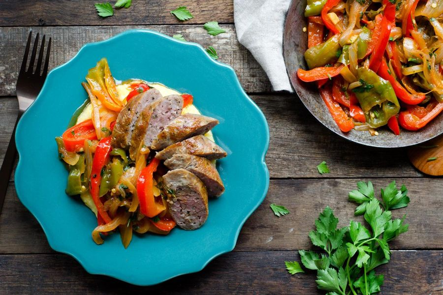 Pan-seared sausages with sweet peppers and polenta