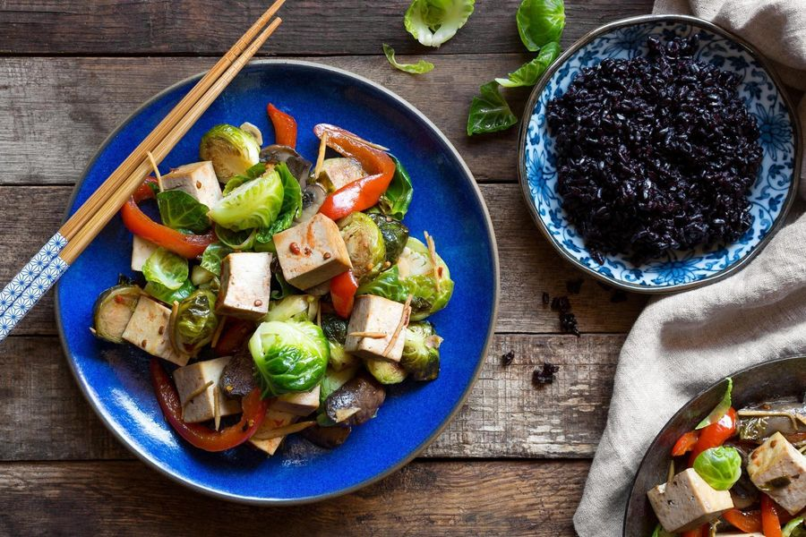 Tofu stir-fry with Brussels sprouts, cremini mushrooms, and black rice